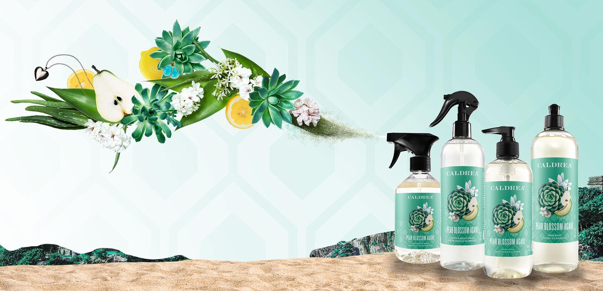 A collection of countertop spray, dish soap, and more spray out elements that encompass our scent: Pear Blossom Agave.