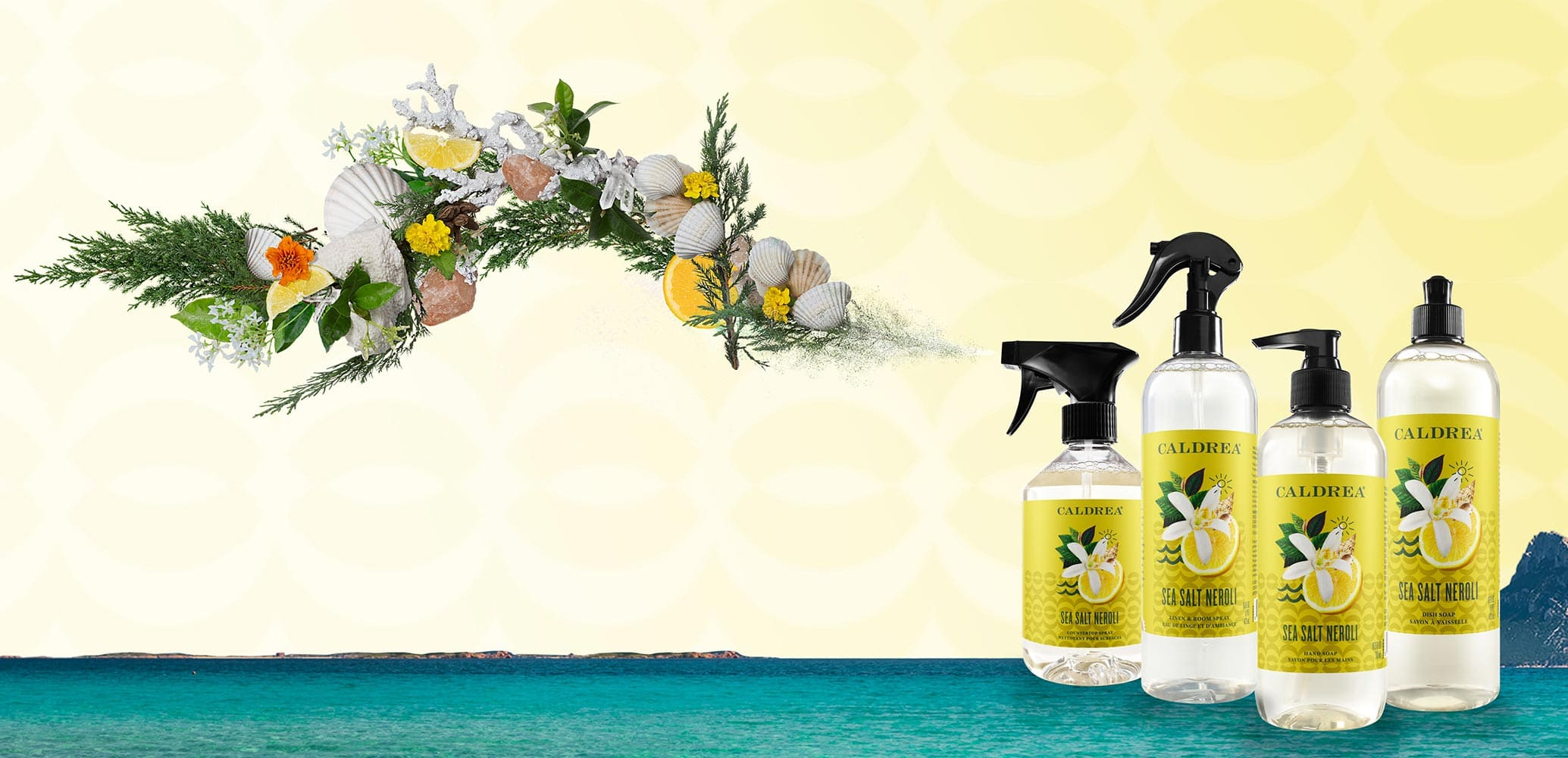 A collection of countertop spray, dish soap, and more spray out elements that encompass our scent: Sea Salt Neroli.